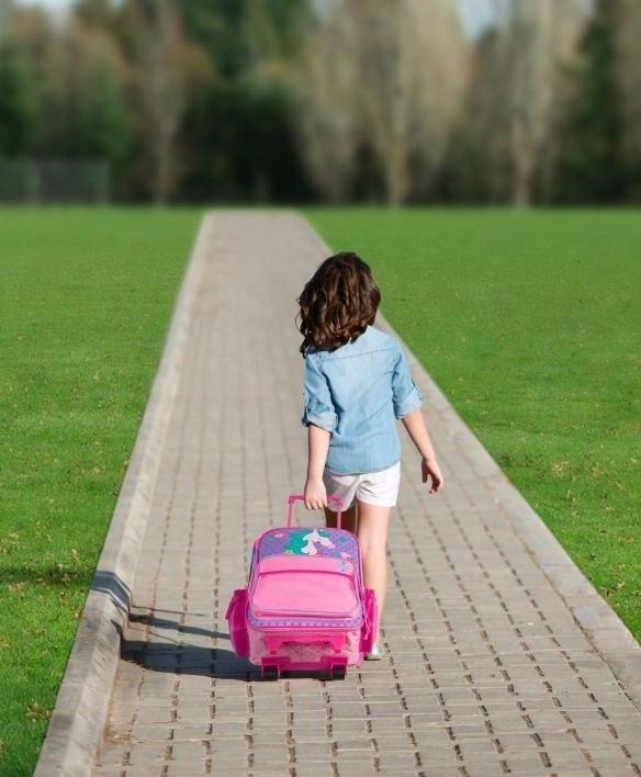 kids rolling luggage and name tag travel